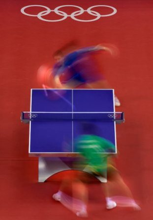 Tsuboi Gustavo of Brazil (bottom) and Peter-Paul Pradeeban of Canada playing table tennis in this long exposure from overhead. Photo by Vincent Laforet for NEWSWEEK
